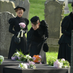 Lizzie and Emma. They never got out of the carriage at the funeral in reality.