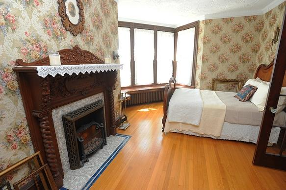 "Room at the front of the house on the second floor. ""When My Fire Burns Low"" fireplace on the left."